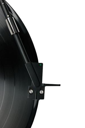 Tonearm on vinyl LP and black green dot pickup headshell, isolated hi-fi record player tone arm macro closeup photo