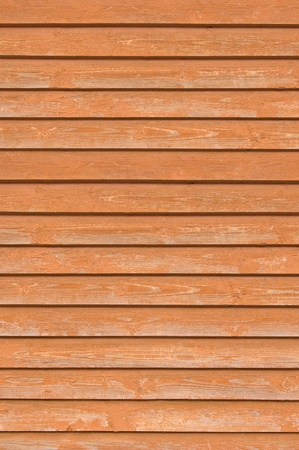 Natural old wood fence planks, wooden close board texture, overlapping light reddish brown closeboard terracotta background pattern