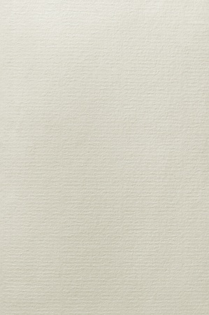 Cotton Rag paper, natural texture background, vertical copyspace in beige sepia photo
