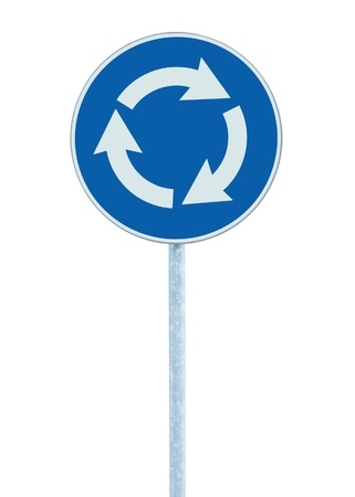 Roundabout crossroad road traffic sign isolated, blue, white arrows left hand Stock Photo - 9951587