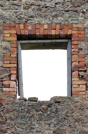 Ruined rustic limestone boulder rubble wall masonry stonework ruins and empty blank isolated red brick window aperture opening with weathered old aged wooden frame photo