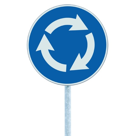 Roundabout crossroad road traffic sign isolated, blue, white arrows left hand photo