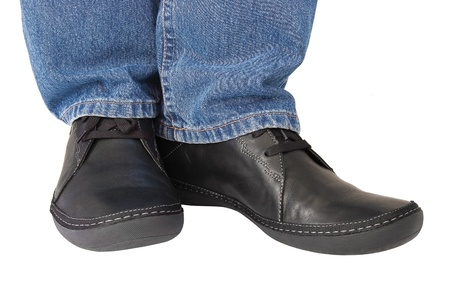 Black leather shoes, blue denim indigo jeans, casual men Stock Photo - 10555327