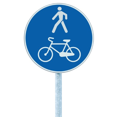 lanes: Bicycle and pedestrian lane road sign on pole post, large blue round isolated bike cycling and walking walkway footpath route traffic roadside signage