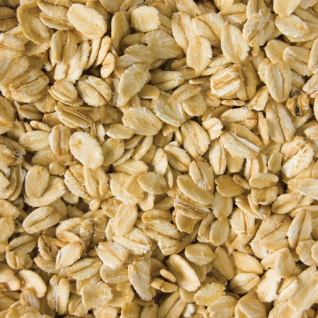 Oatmeal background, rolled raw oats, detailed macro closeup photo