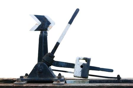 Oude verweerde roestige grungy spoorweg punten switch mechanische handmatige spoorweg opkomst pijl, retro grunge geïsoleerde close-up Stockfoto