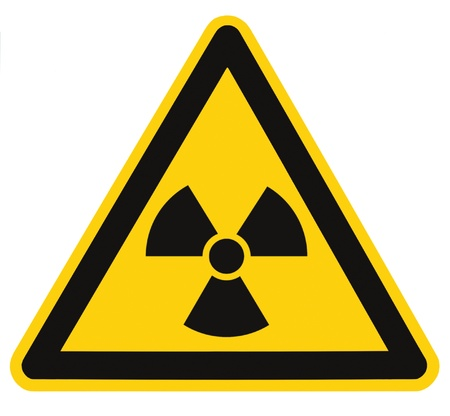 Radiation hazard symbol sign of radhaz threat alert icon, isolated black yellow triangle signage macro photo