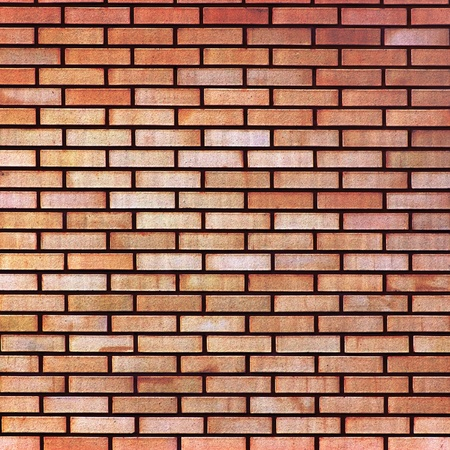Red yellow beige tan fine brick wall texture background, large closeup Stock Photo