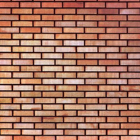 Rood geel beige bruin fijne bakstenen muur textuur achtergrond, grote close-up