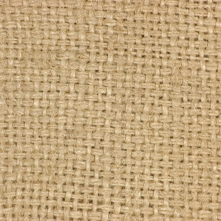 Macro of natural textured burlap sackcloth hessian texture coffee sack, light country sacking canvas, macro background