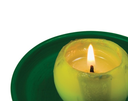 candle flame: Green lit candle macro closeup, isolated glowing flame Stock Photo