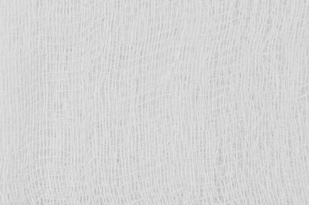 Witte medische bandage gaas textuur, abstracte geweven achtergrond macro close-up, natuurlijk katoen linnen stof, kopie ruimte