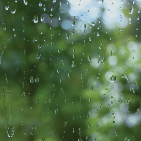 clear day: Rainy summer day, raindrops on window glass, macro closeup