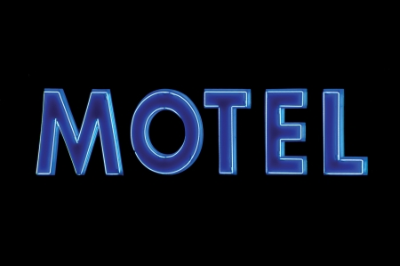 Blue Neon Motel sign lit up at night photo