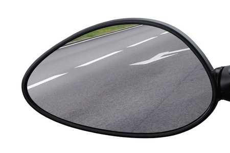 Rear view mirror reflecting road, left side lateral, macro closeup, tarmac asphalt background reflection, white lines, arrows marking photo