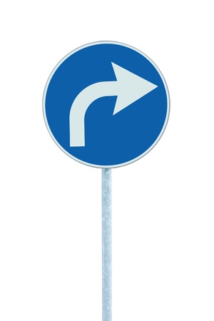 turn left: Turn right ahead sign, blue round isolated roadside traffic signage, white arrow icon and frame roadsign, grey pole post Stock Photo