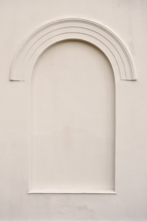 Old aged plastered faux arch false fake window stucco frame background copy space, light dark beige sepia texture photo