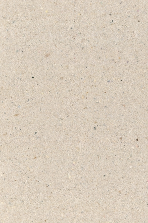 Wrapping paper cardboard texture, light rough textured copy space background, grey, gray, brown, tan, yellow, beige