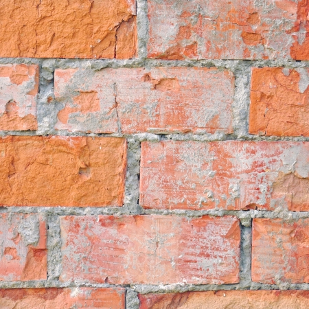 Light red brick wall texture macro closeup, old detailed rough grunge cracked textured bricks copy space background, grungy weathered stained vintage brickwork cut vertical pattern photo