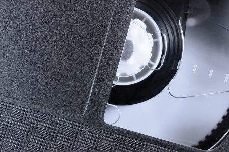 VHS Tape Macro Closeup, large detailed black retro videotape cassette background, epmty blank vintage copy space photo