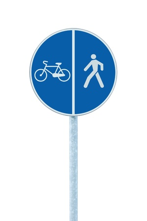 blue signage: Bicycle and pedestrian lane road sign on pole post, large blue round isolated bike cycling and walking walkway footpath route traffic roadside signage