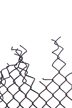 perimeter: Grunge aged weathered crushed rusty wire security fence isolated, vertical copy space