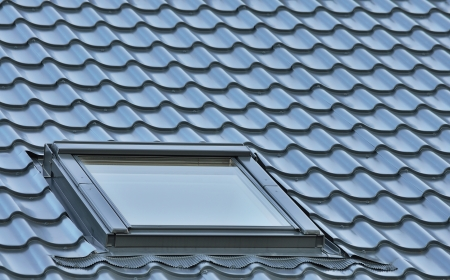 skylights: Roof window on a grey tiled rooftop, large detailed loft skylight background, diagonal roofing pattern