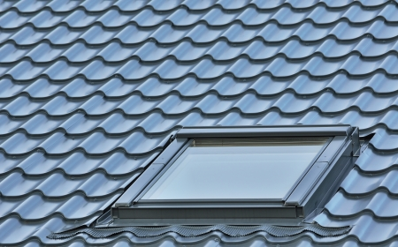 solar roof: Roof window on a grey tiled rooftop, large detailed loft skylight background, diagonal roofing pattern