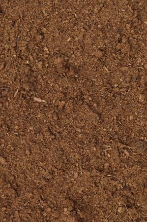 Turf Turf Macro close-up, grote gedetailleerde bruine organische humus bodem achtergrond patroon, verticale