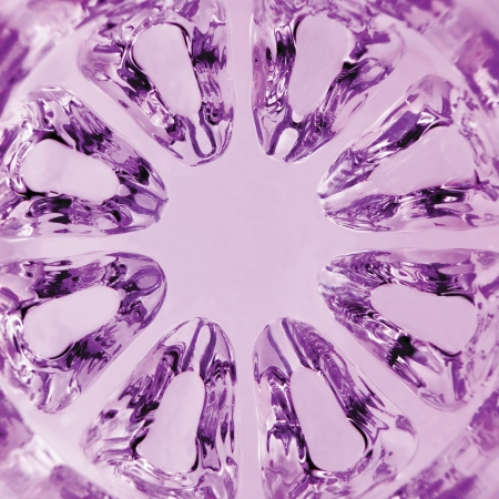 Kaleidoscopic Magenta Texture, spherical glass, vertical macro closeup photo