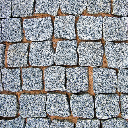 Granite Cobblestone Pavement Texture Background, Large Detailed Stone Block Paving, Rough Cut Textured Grey Pattern Closeup photo