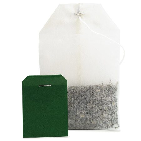 Teabag macro closeup, isolated large detailed green blank empty label copy space black tea bag studio shot photo