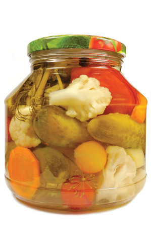 Pickled canned vegetables homemade assortment, isolated glass jar, large detailed macro closeup studio shot, tomatoes, cucumbers, carrots, cauliflowers, dill, garlic peppers photo