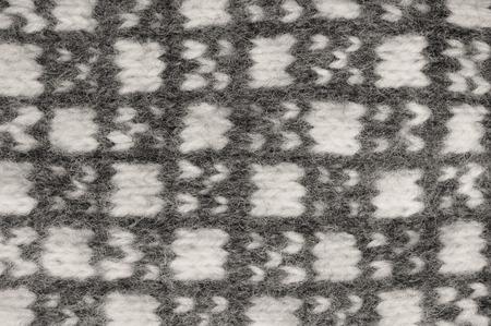 fingerless gloves: Gray mitten background, grey white textured woolen mittens pattern, knitted warm wool winter fingerless gloves detail, large detailed horizontal vintage texture macro closeup Stock Photo
