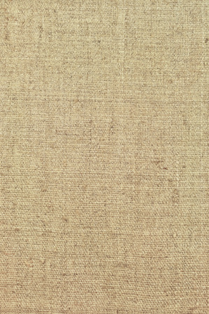 Natural textured vertical grunge burlap sackcloth hessian sack texture, grungy vintage country sacking canvas, large detailed bright beige pattern macro background closeup photo