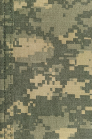 acu: Universal camouflage pattern, army combat uniform digital camo, double thread seam, USA military ACU macro closeup, detailed large rip-stop fabric texture background, foliage green, yellow desert sand tan, urban gray grey NYCO, nylon, cotton, vertical tex Stock Photo