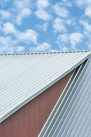 panel: Industrial building roof sheets, grey steel rooftop pattern, bright summer clouds cloudscape, blue sky, rifled roofing panels, large detailed ocher painted wood texture, textured construction background, red ochre paint wooden wall closeup, vertical gray  Stock Photo