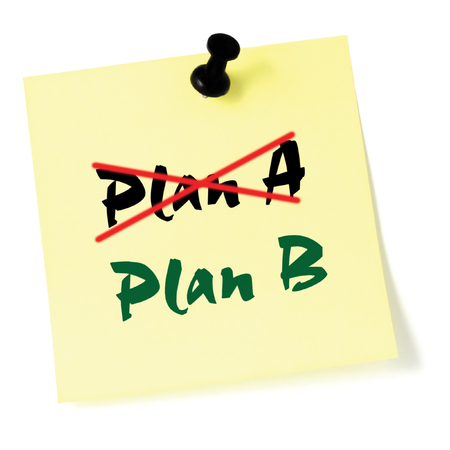 thumbtacked: Crossing out Plan A, writing Plan B, Yellow Post-It Style Sticky Note Macro Closeup, Large Detailed Thumbtacked Sticker Adhesive Memo Stock Photo
