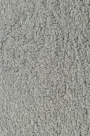 turkish bath: Grey natural plush terry cloth turkish bath beach towel, textured fabric macro background closeup vertical texture pattern