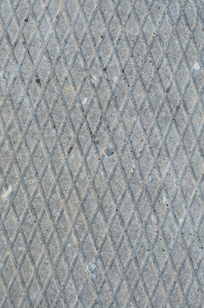 groove: Old grey weathered concrete plate, rough grunge abstract cement tile texture diagonal groove pattern macro closeup, diagonally grooved large detailed vertical textured gray footbridge walkway background, natural rustic grungy stained vintage sidewalk path