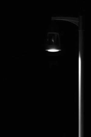 desolated: Bright Lit Outdoor Lantern Lamp Pole Post, Lonely Concept Solitude Metaphor, Illuminated Window Light, Vertical Deserted Night Park Scene Closeup, Black Isolated Copy Space Background