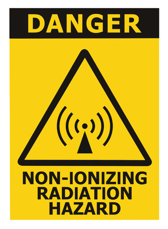 excitation: Non-ionizing radiation hazard safety area, danger warning text sign sticker label, large icon signage, isolated black triangle over yellow, macro closeup Stock Photo