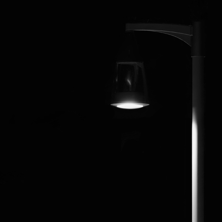 lamp on the pole: Bright Lit Outdoor Lantern Lamp Pole Post, Lonely Concept Solitude Metaphor, Illuminated Window Light, Vertical Deserted Night Park Scene Closeup Black Isolated Copy Space Background