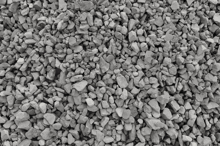 gravel: Abstract grey and beige gravel stone background, crushed gray stones and granite pieces texture, large detailed horizontal textured rough construction rock material mix pattern