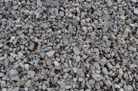 Streszczenie szary i beżowym tle kamienia żwiru, kruszone szare kamienie i granitowe kawałki tekstury, duże szczegółowe poziome teksturowanej surowca konstrukcji rock wzorzec mieszania materiału