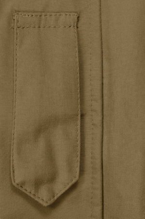 storm background: Coyote Tan ECWCS Parka Rank Insignia Badge Loop Closeup, Blank Empty Vertical Apparel Background Copy Space, Front Placket Storm Flap, Large Detailed Macro Stock Photo