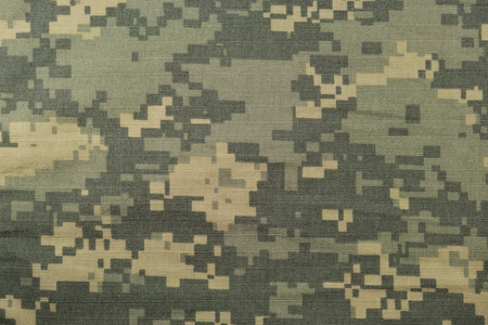 Universal camouflage pattern, army combat uniform digital camo, USA military ACU macro closeup, detailed large rip-stop fabric texture background, crumpled, wrinkled, foliage green, yellow desert sand tan, urban gray grey NYCO, nylon, cotton, horizontal t Reklamní fotografie