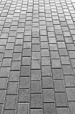 grey background texture: Grey Cobblestone Pavement Texture Background, Large Detailed Vertical Gray Stone Block Paving Perspective, Rough Textured Cobble Pattern Closeup