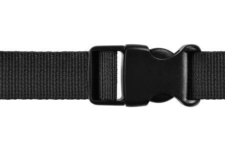 Cierre de plástico con hebilla acculoc de liberación lateral negra, correa de bloqueo de cuerda de cinturón de nailon rápido, primer plano macro aislado, disparo de estudio de accesorios horizontales detallado grande