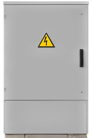 Power distribution wiring switchboard panel outdoor unit, grey brand new distributing board compartment box, gray cabinet, yellow high voltage warning triangle sign, large detailed vertical isolated closeup